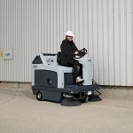 Ride-on sweeper / battery-powered